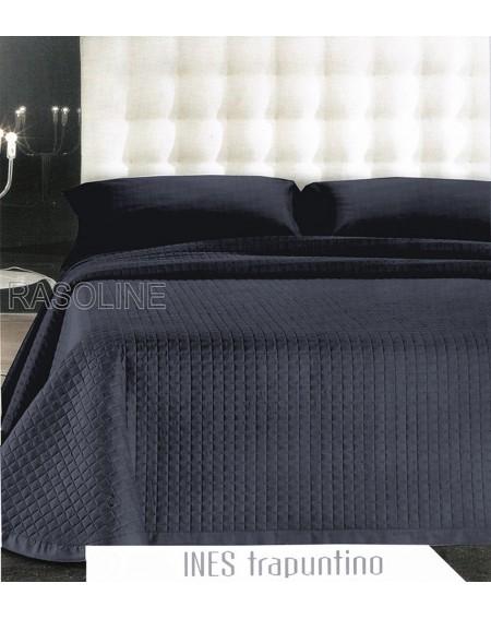 Cubrecama de tejido saten azul